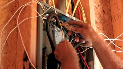 stock-footage-electrician-wiring-breaker-box-in-new-construction