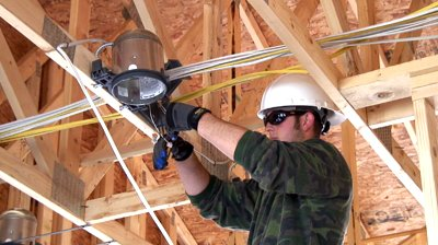 stock-footage-new-home-construction-electrician-installing-a-ceiling-light-ambient-audio-included